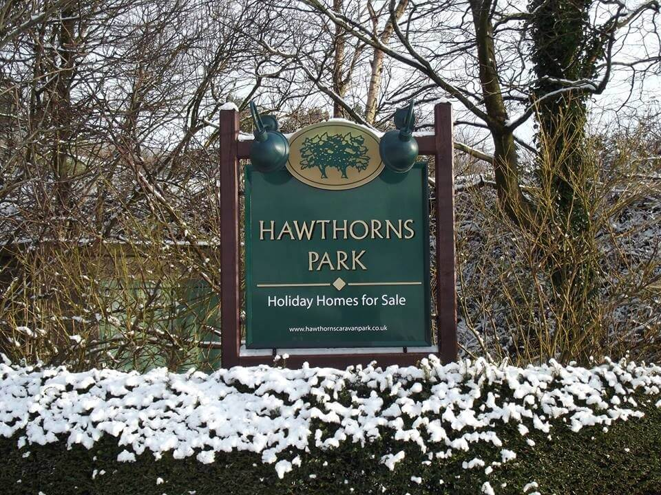 hawthorns park sign covered in snow