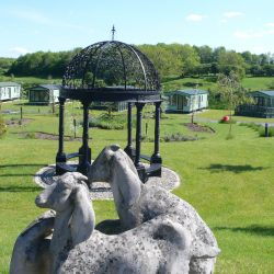 Stone sheep in The Glade, static caravan park development
